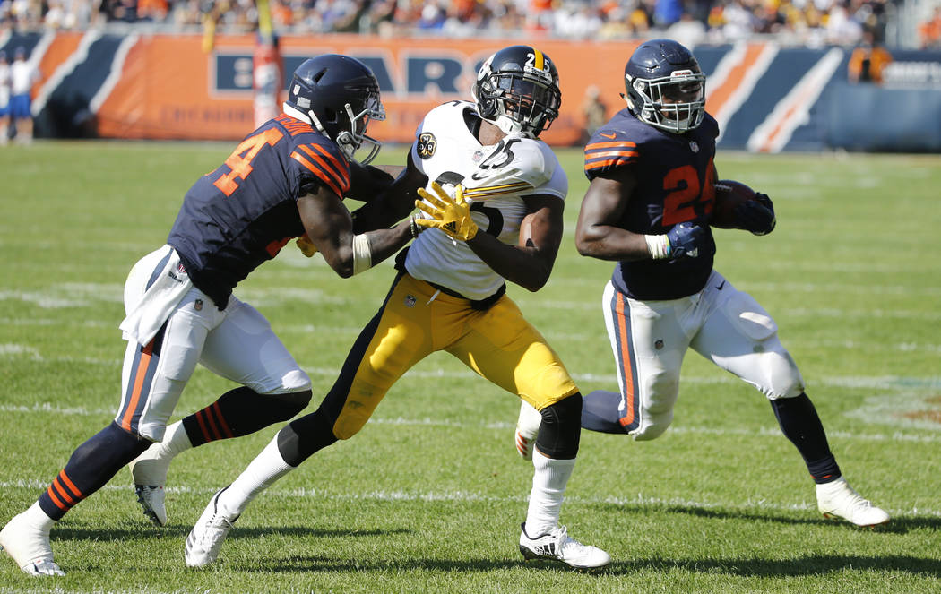 Chicago Bears running back Jordan Howard (24) runs to the end zone for a touchdown in overtime of an NFL football game, Sunday, Sept. 24, 2017, in Chicago. Bears receiver Deonte Thomspon (14) bloc ...