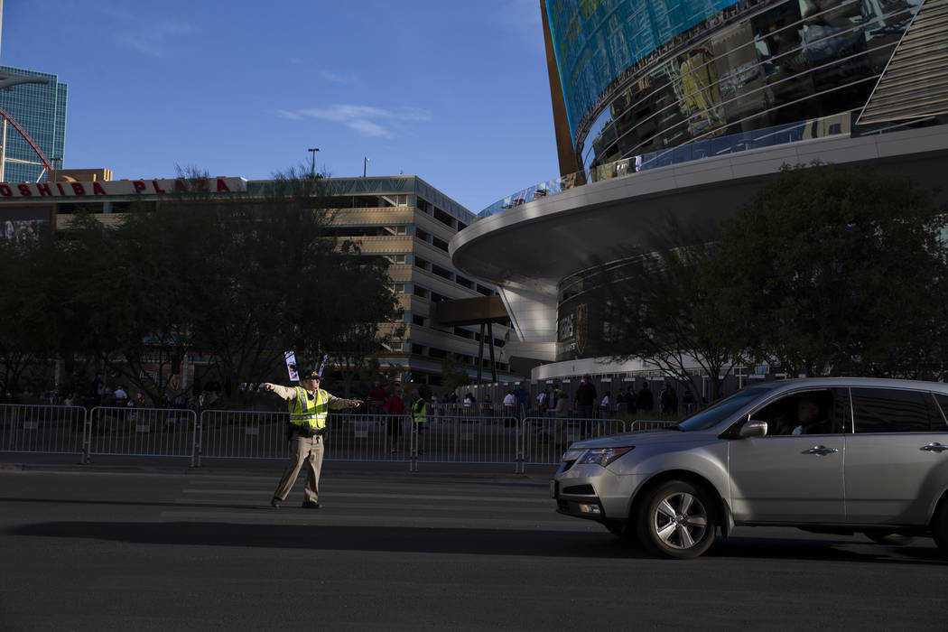 A Las Vegas police officer directs traffic before the first preseason home game for the Vegas Golden Knights at T-Mobile Arena in Las Vegas, Tuesday, Sept. 26, 2017. Erik Verduzco Las Vegas Review ...