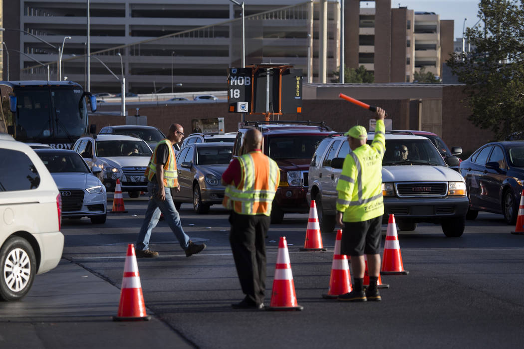 Traffic guards direct vehicles before the first preseason home game for the Vegas Golden Knights at T-Mobile Arena in Las Vegas, Tuesday, Sept. 26, 2017. Erik Verduzco Las Vegas Review-Journal @Er ...