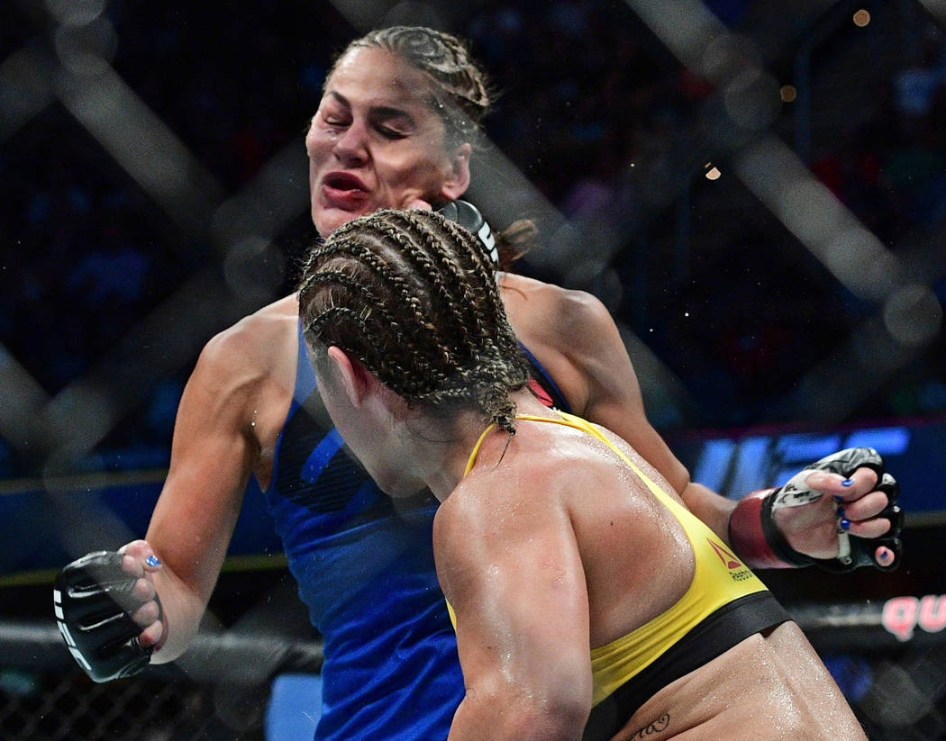 Bethe Correia, from Brazil, punches Jessica Eye during a women's bantamweight bout at UFC 203 on Saturday, Sept. 10, 2016, in Cleveland. (AP Photo/David Dermer)