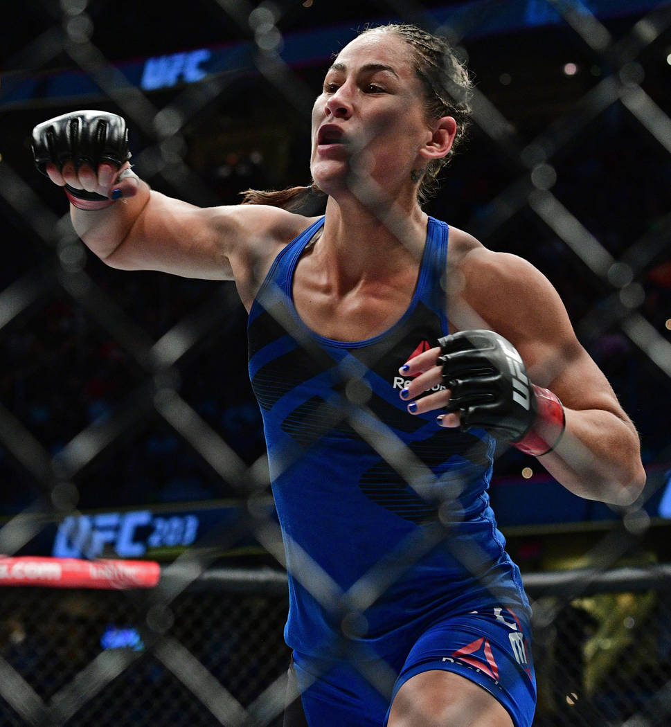 Jessica Eye in action against Bethe Correia during a women's bantamweight bout at UFC 203 on Saturday, Sept. 10, 2016, in Cleveland. Bethe Correia won via split decision. (AP Photo/David Dermer)