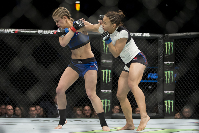 Michelle Waterson, right, throws a punch against Paige VanZant in the women's strawweight bout at the Golden 1 Center on Saturday, Dec. 17, 2016, in Sacramento, Calif. Waterson won by way o ...