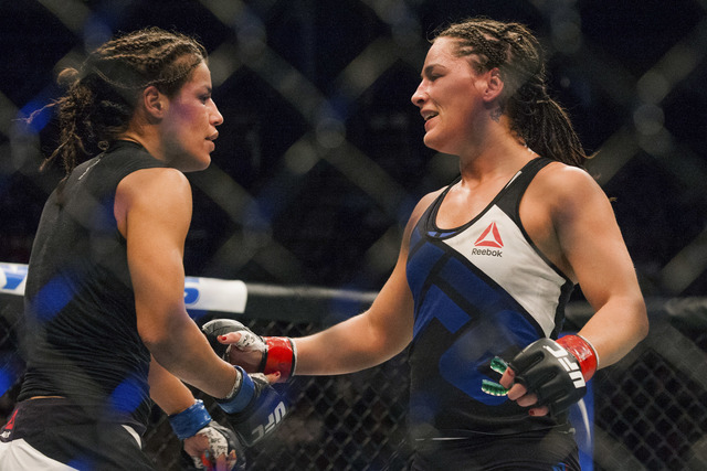 UFC bantamweight Julianna Pena, left,  and Jessica Eye meet in the ring after their match during the UFC 192 mixed material arts bout at MMA UFC 192, Saturday, Oct. 3, 2015 in Houston, Texas. Pena ...