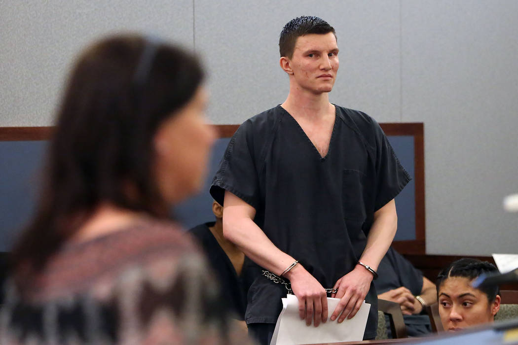 Mason Fritz looks at his mother, Dawn Fritz, as she prepares to read a victim impact statement during Fritz's sentencing at the Regional Justice Center on Tuesday, Sept. 26, 2017, in Las Vegas. Fr ...