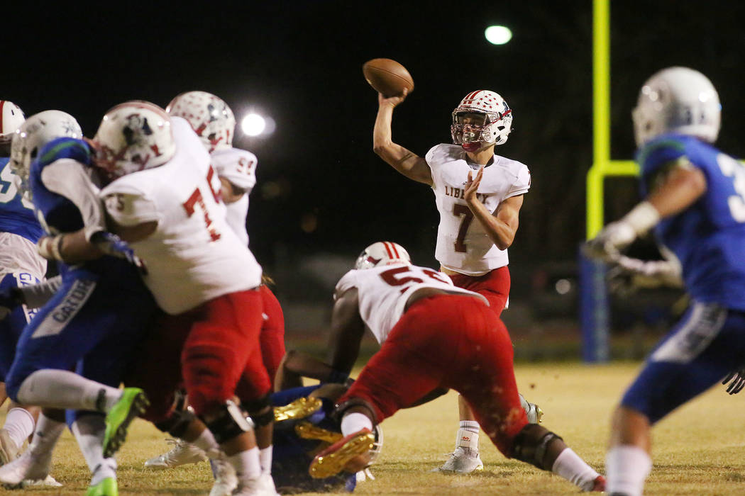 Liberty quarterback Kenyon Oblad (7) passes the ball during the first half of a game against Green Valley at Green Valley High School in Henderson, Thursday, Sept. 28, 2017. Bridget Bennett Las Ve ...