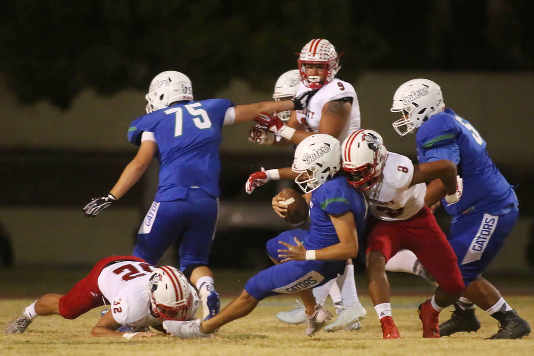 Liberty's Austin Fiaseu (8) takes down Green Valley quarterback A.J. Barilla during the first half of a game at Green Valley High School in Henderson, Thursday, Sept. 28, 2017. Bridget Bennett Las ...