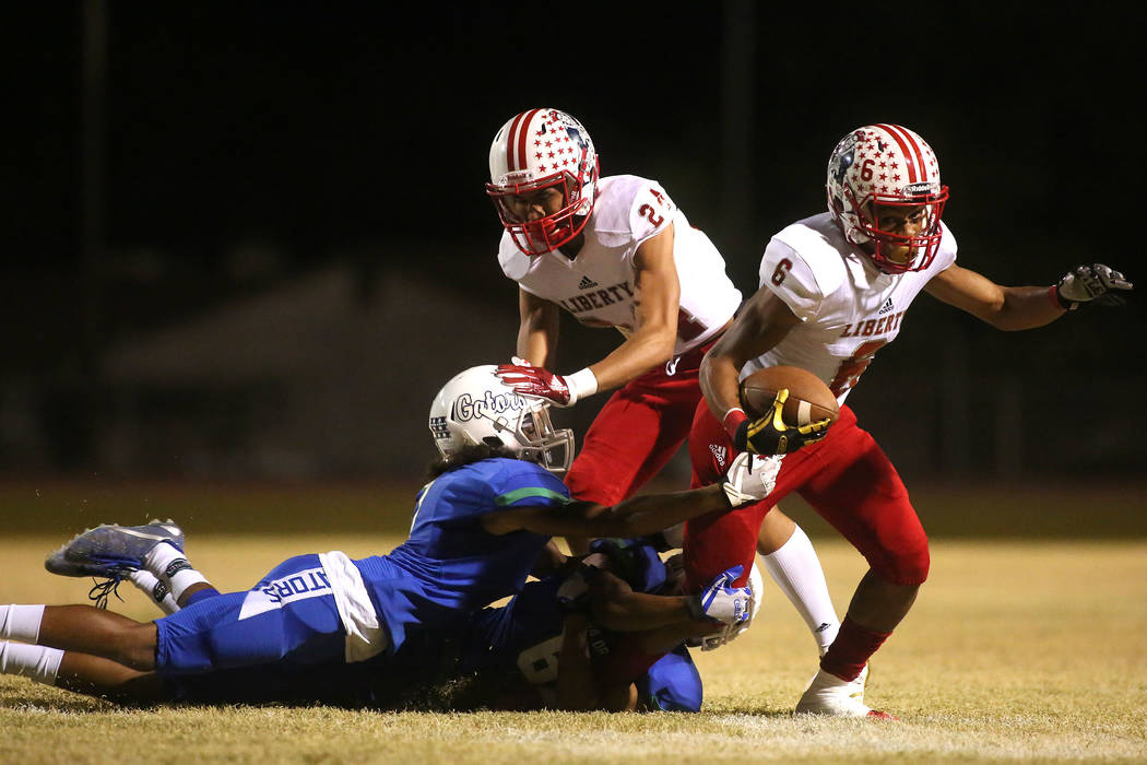Green Valley players tackle Liberty player Cervontes White (6) during the first half of a game at Green Valley High School in Henderson, Thursday, Sept. 28, 2017. Bridget Bennett Las Vegas Review- ...