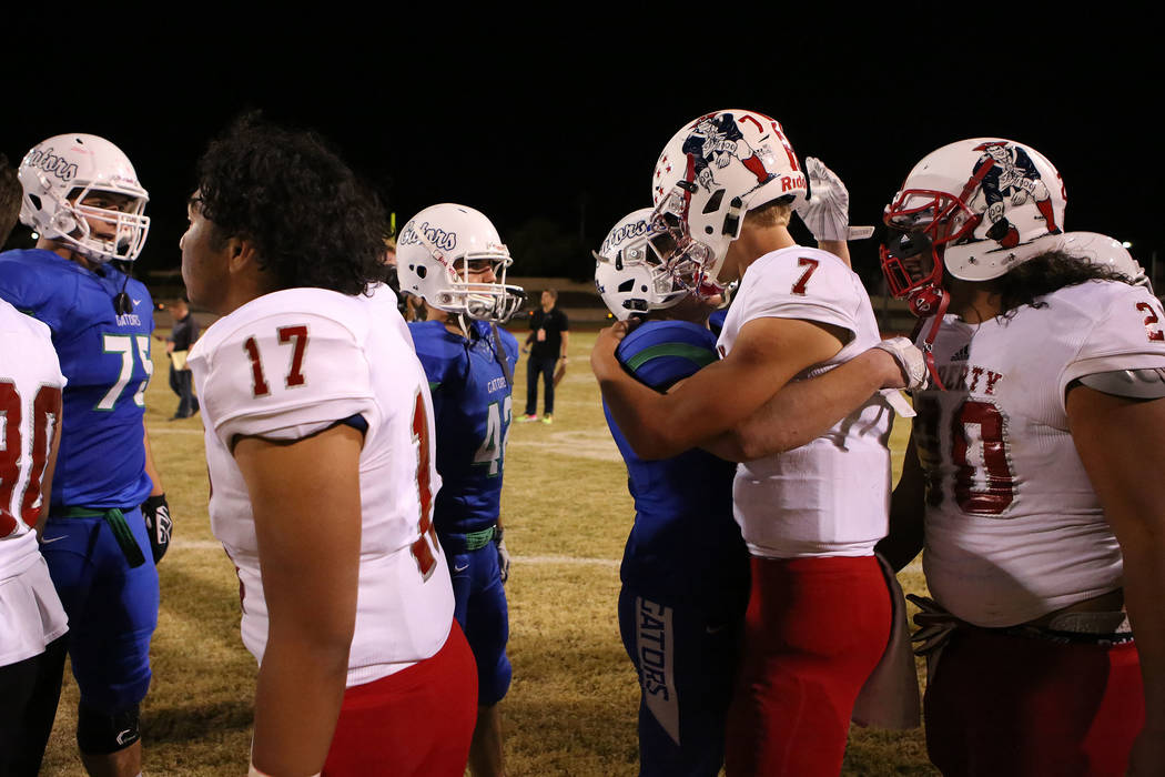 A Green Valley player hugs Liberty quarterback Kenyon Oblad (7) after Liberty's 49-14 win over at Green Valley High School in Henderson, Thursday, Sept. 28, 2017. Bridget Bennett Las Vegas Review- ...