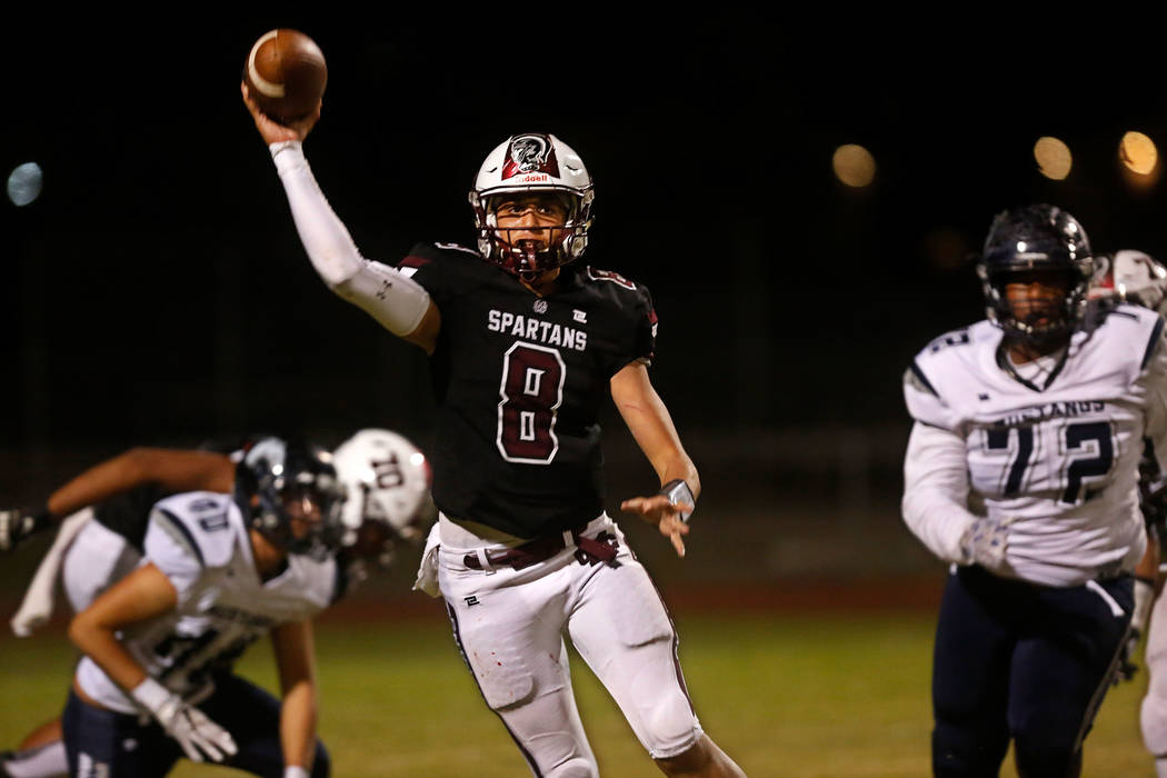 Cimarron-Memorial quarterback George Tribble Jr.(8) throws a pass during the first half of a football game at Cimarron-Memorial High School in Las Vegas, Thursday, Sept. 28, 2017,  as Shadow Ridge ...