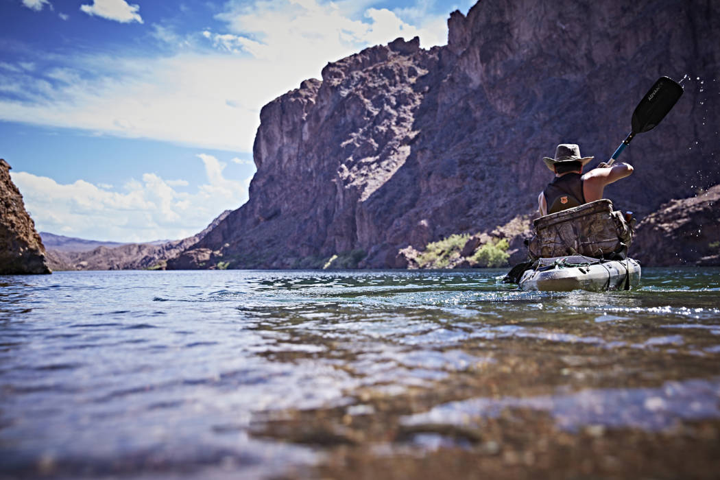 A kayaker paddles on the Colorado River downstream from Hoover Dam. A new treaty agreement between the U.S. and Mexico is expected to keep more water in the overdrawn and drought stricken river. ( ...