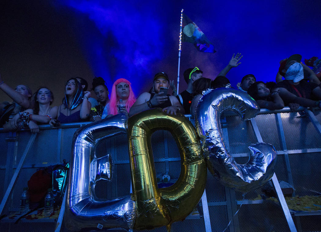 "Attendees hold up ballots that spell out ""EDC"" during Dillon Francis' set at Kinetic Field on the second night of Electric Daisy Carnival at Las Vegas Motor Speedway on Sunday, June 18, 2017 in La ..."
