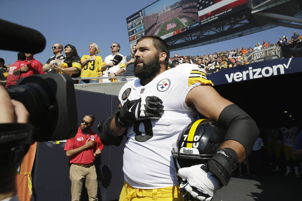 Pittsburgh Steelers offensive tackle and former Army Ranger Alejandro Villanueva (78) stands outside the tunnel alone during the national anthem before an NFL football game against the Chicago Bea ...