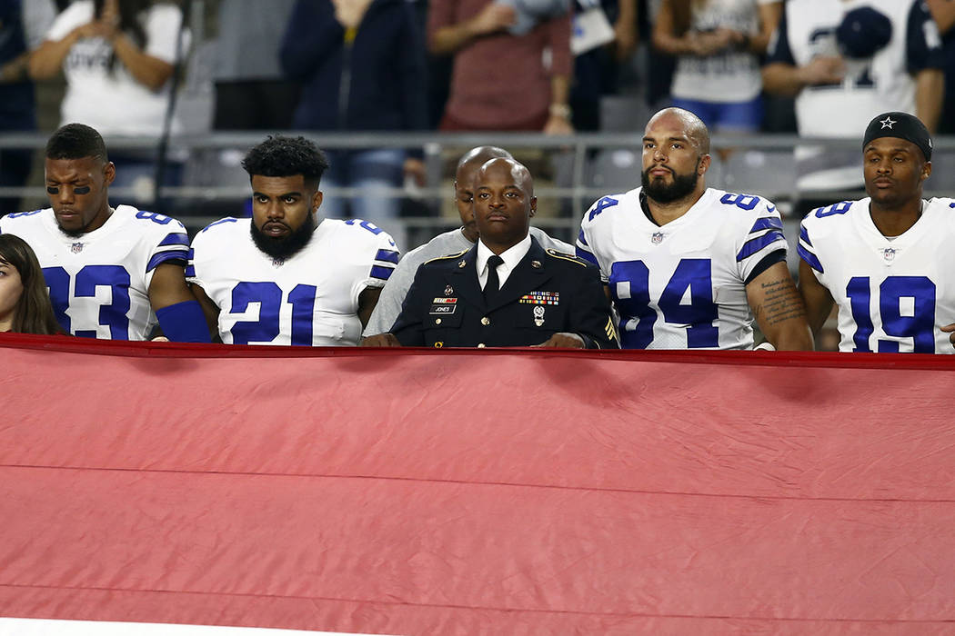 The Dallas Cowboys stand during the national anthem prior to an NFL football game against the Arizona Cardinals, Monday, Sept. 25, 2017, in Glendale, Ariz. (AP Photo/Ross D. Franklin)