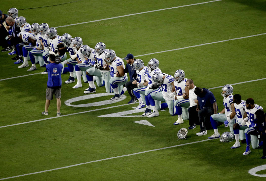 The Dallas Cowboys take a knee prior to the national anthem prior to an NFL football game against the Arizona Cardinals, Monday, Sept. 25, 2017, in Glendale, Ariz. (AP Photo/Matt York)