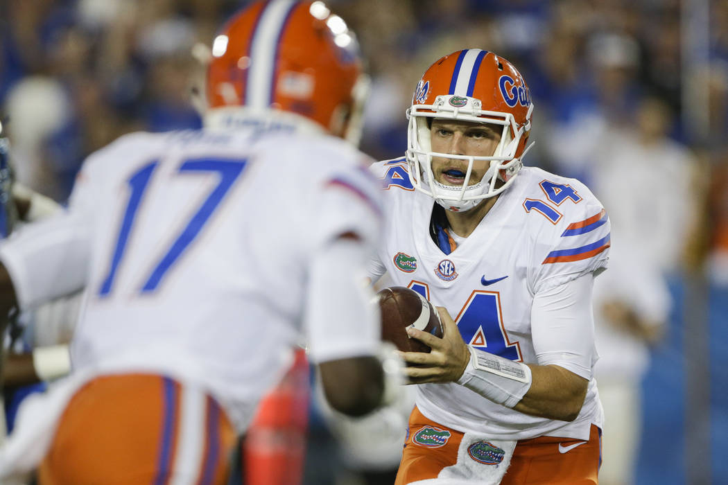 Florida quarterback Luke Del Rio looks to hand off the ball to Kadarius Toney during the second half of an NCAA college football game Saturday, Sept. 23, 2017, in Lexington, Ky. Florida won the ga ...