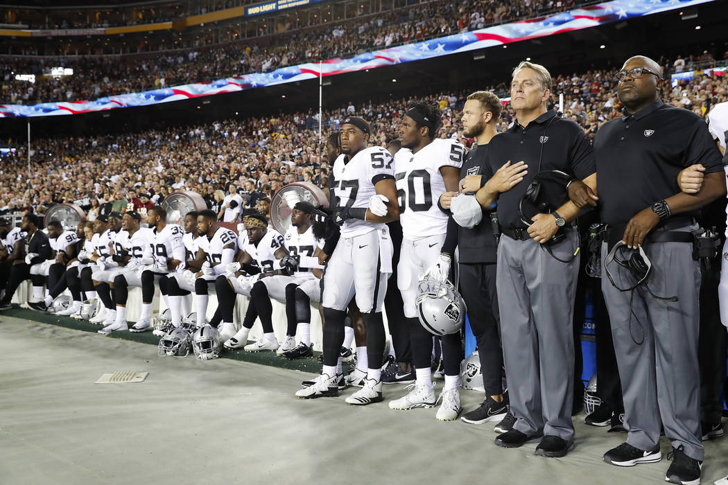 Some members of the Oakland Raiders sit on the bench during the national anthem before an NFL football game against the Washington Redskins in Landover, Md., Sunday, Sept. 24, 2017. (AP Photo/Alex ...