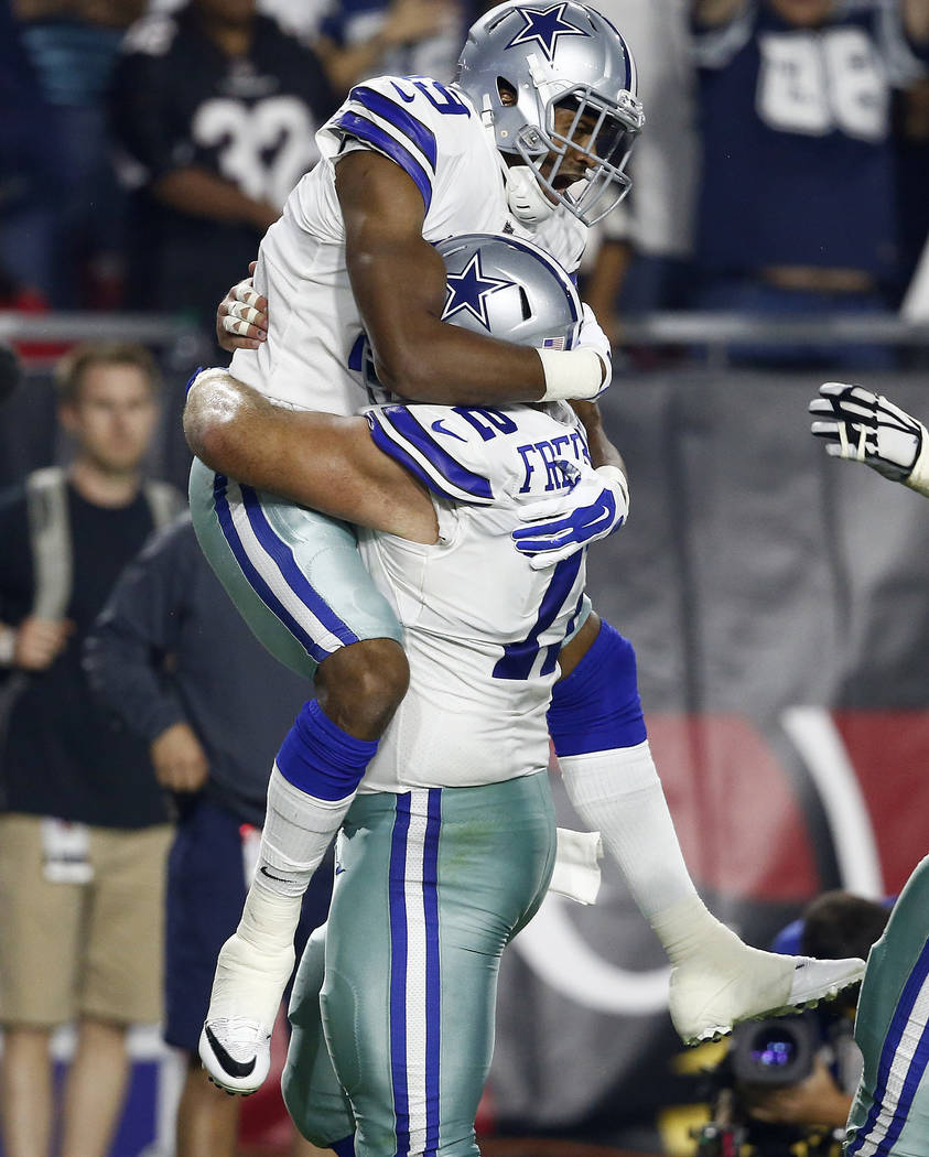 Dallas Cowboys wide receiver Brice Butler (19) celebrates his touchdown against the Arizona Cardinals with Dallas Cowboys center Travis Frederick (72) during the second half of an NFL football gam ...