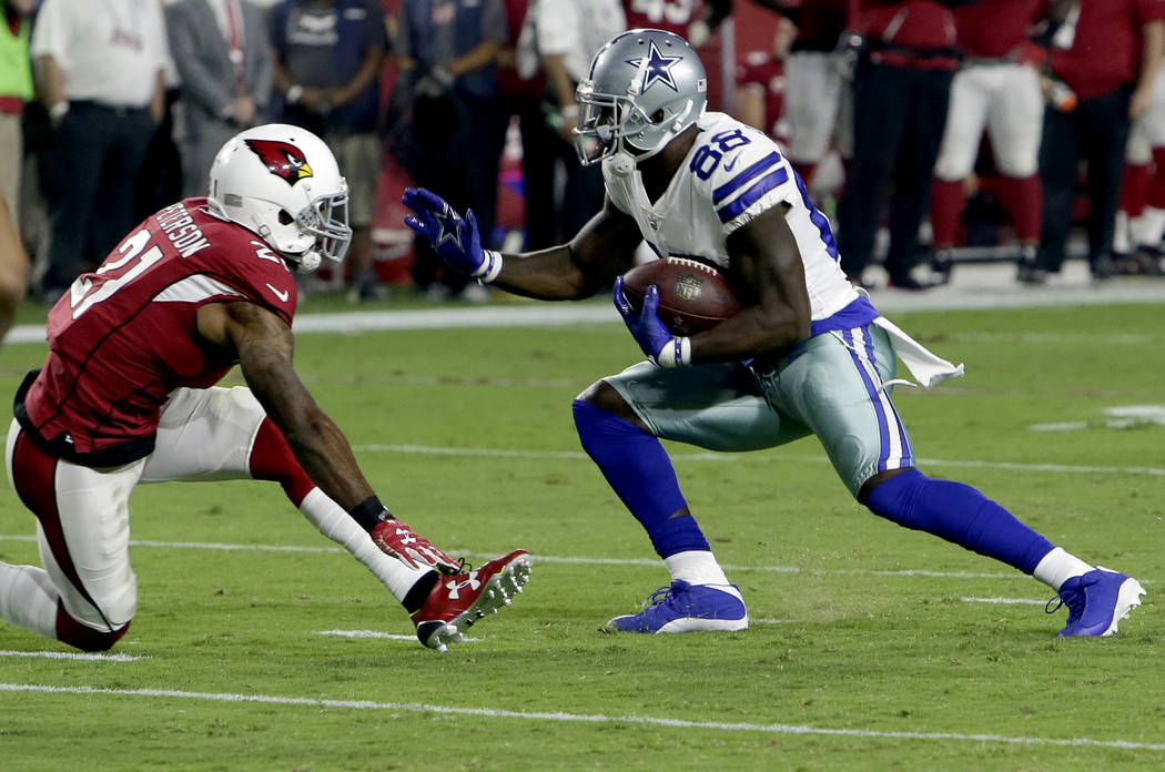 Dallas Cowboys wide receiver Dez Bryant (88) eludes Arizona Cardinals cornerback Patrick Peterson (21) for a touchdown during the second half of an NFL football game, Monday, Sept. 25, 2017, in Gl ...