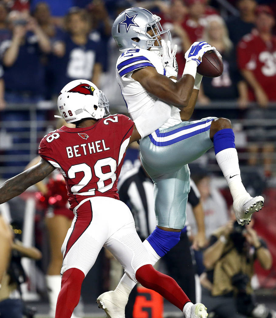 Dallas Cowboys wide receiver Brice Butler (19) pulls in a touchdown catch as Arizona Cardinals cornerback Justin Bethel (28) defends during the second half of an NFL football game, Monday, Sept. 2 ...