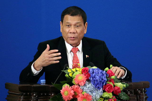 Philippines President Rodrigo Duterte makes a speech during the Philippines - China Trade and Investment Forum at the Great Hall of the People in Beijing, China, October 20, 2016. (Wu Hong/Reuters)
