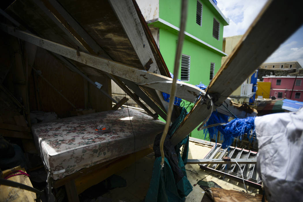 A hat rests on a bed surrounded by debris after Hurricane Maria, in San Juan, Puerto Rico, Monday, Sept. 25, 2017. The island territory of more than 3 million U.S. citizens is reeling in the devas ...