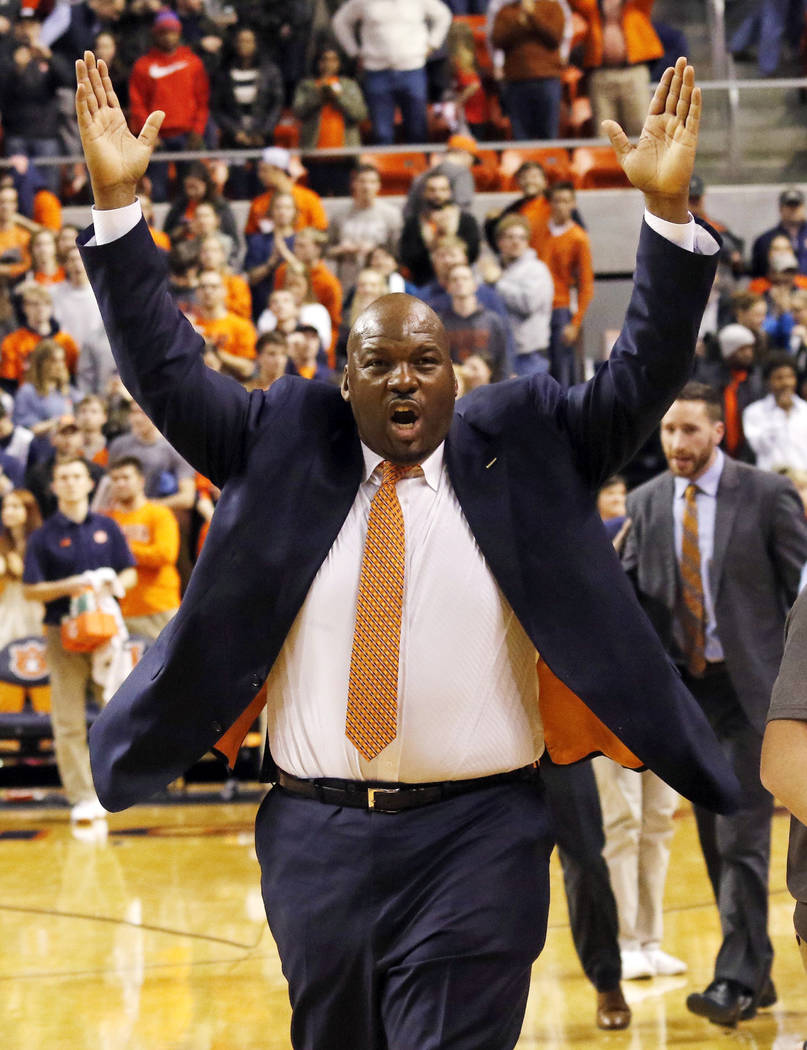 FILE - In this Jan 19, 2016, file photo, Auburn assistant coach Chuck Person celebrates after they defeated Alabama 83-77 in an NCAA college basketball game in Auburn, Ala. Person was identified i ...