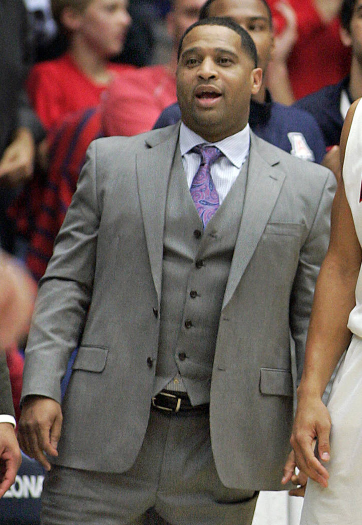 FILE - In this Dec. 11, 2013, file photo, Arizona's assistant coach Emanuel Richardson watches from the sideline during the second half of an NCAA college basketball game against New Mexico State  ...
