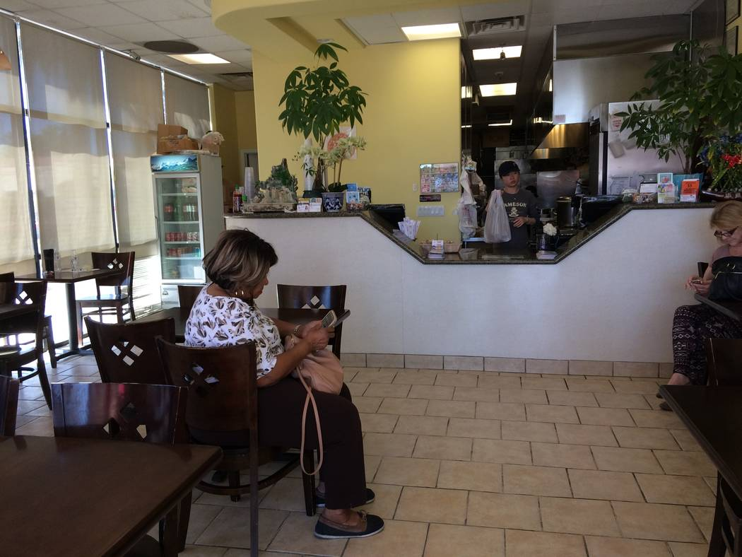 A woman waits for her to-go order Sept. 25, 2017, at  N. Y. Chinese Restaurant. The eatery opened in 2008 and had such a strong following, it opened another location in Green Valley a few years la ...