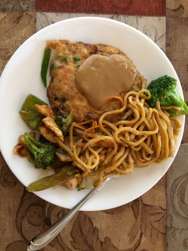 Egg foo young and garlic chicken from N. Y. Chinese Restaurant are seen Sept. 25, 2017. (Jan Hogan/View)