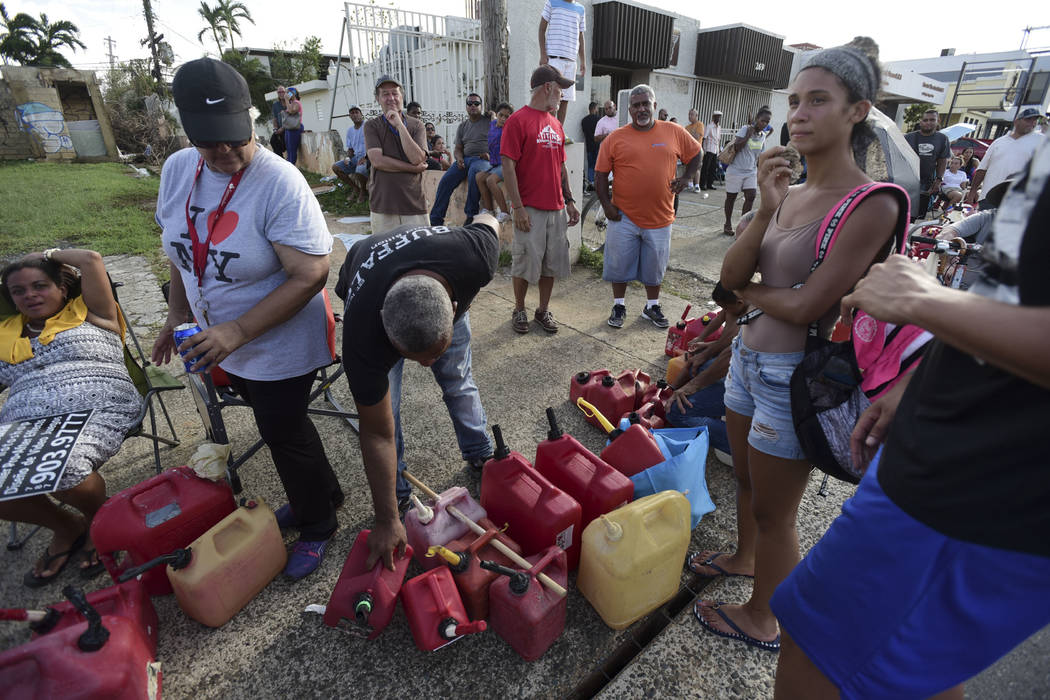 Hundreds of people wait in line since the morning to buy gasoline three days after the impact of Hurricane Maria in Carolina, Puerto Rico, Saturday, Sept. 23, 2017. A humanitarian crisis grew Satu ...