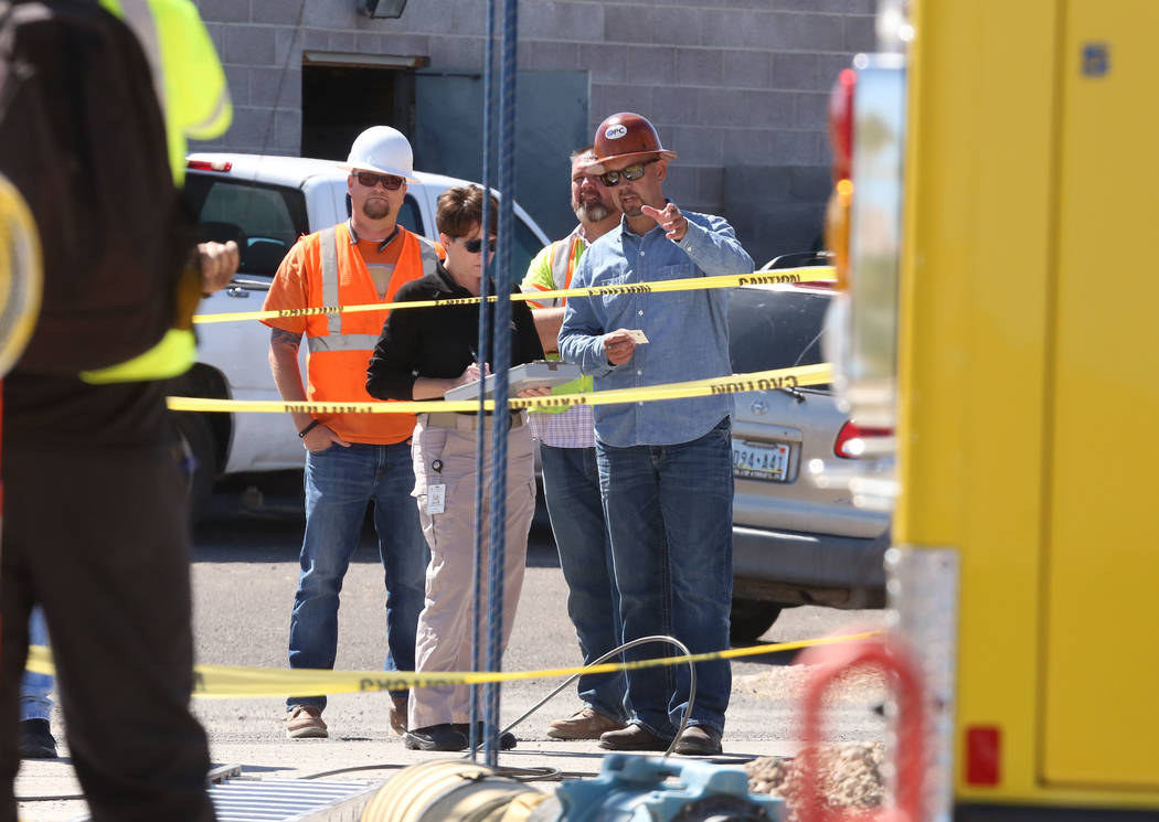 Construction workers watch as Henderson firefighters work at the scene of a fatal construction accident on Jonathan Drive and Las Vegas Boulevard on Monday Sept. 25, 2017, in Las Vegas. (Bizuayehu ...