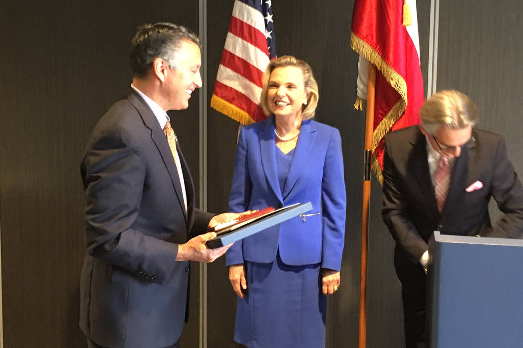 Gov. Brian Sandoval accepts the Friend of Poland award from Polish Senator Anna Maria Anders at a luncheon Tuesday, Sept. 26, 2017, in Reno. Sean Whaley Las Vegas Review-Journal