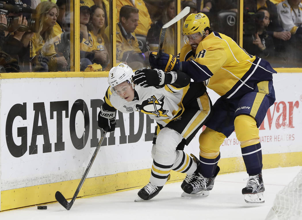 Pittsburgh Penguins' Olli Maatta (3), of Finland, and Nashville Predators' James Neal (18) battle for the puck during the first period of Game 6 of the NHL hockey Stanley Cup Final, Sunday, June 1 ...