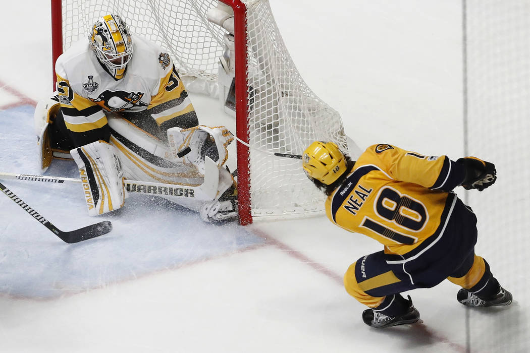 Pittsburgh Penguins goalie Matt Murray (30) blocks a shot by Nashville Predators' James Neal (18) during the second period of Game 6 of the NHL hockey Stanley Cup Final, Sunday, June 11, 2017, in  ...