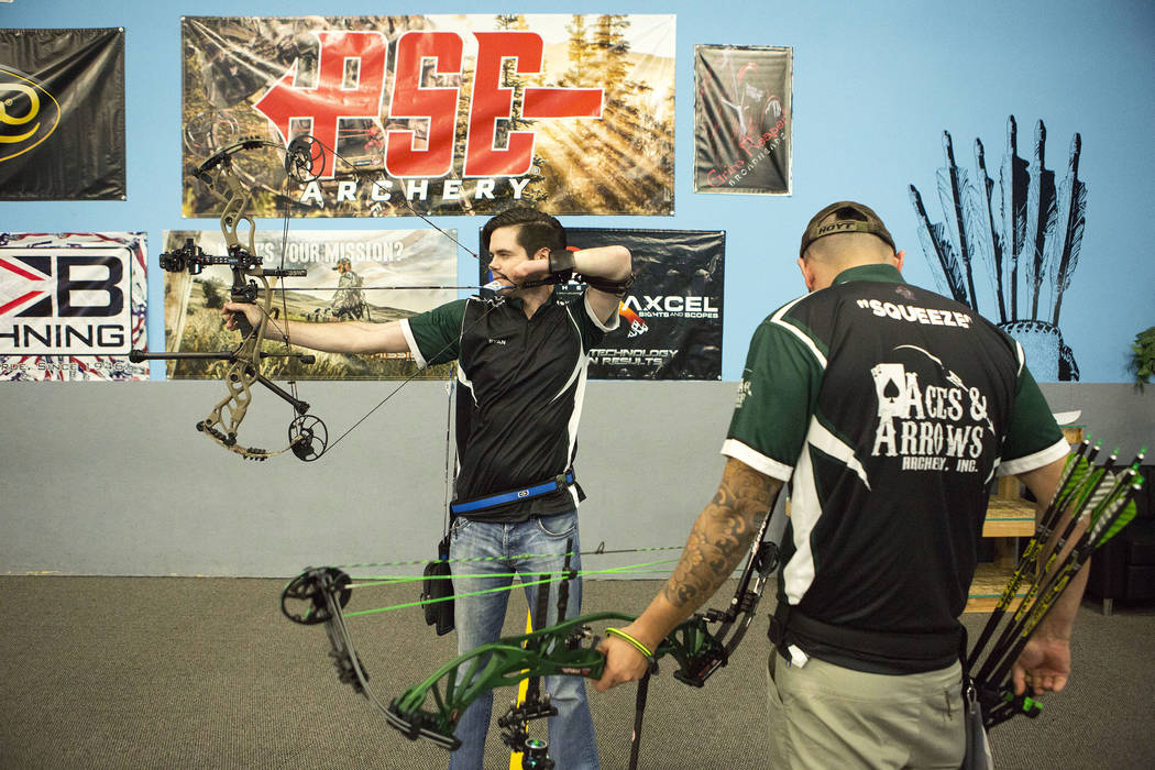 Ryan Sidor, left, and AJ Hanagata shoot at Aces and Arrows in Henderson, Thursday, Sept. 28, 2017. The two opened Aces and Arrows, a store and 22-lane range, in August. Bridget Bennett Las Vegas R ...