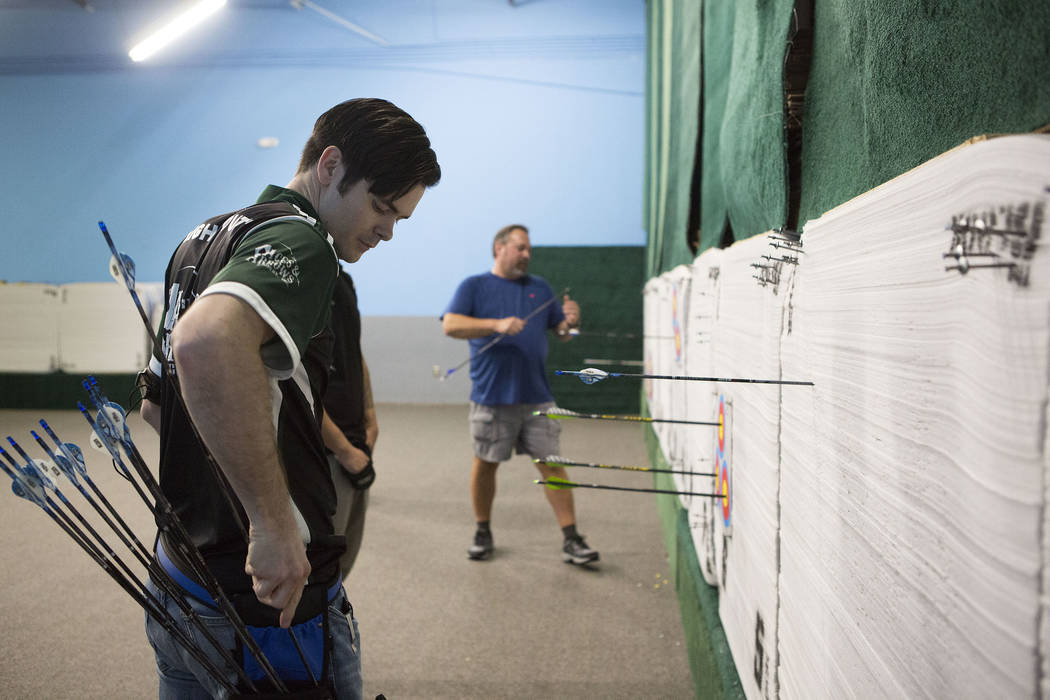 Ryan Sidor pulls his arrows after shooting at Aces and Arrows in Henderson, Thursday, Sept. 28, 2017. Bridget Bennett Las Vegas Review-Journal @BridgetKBennett
