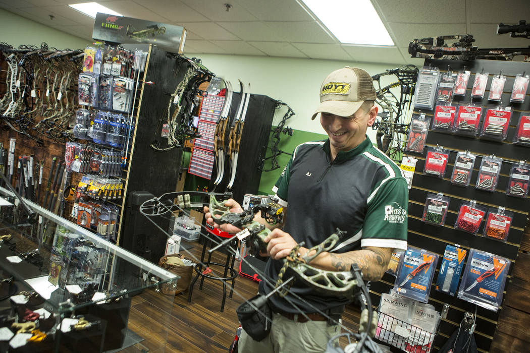 AJ Hanagata helps a customer at Aces and Arrows in Henderson, Thursday, Sept. 28, 2017.  Hanagata and Ryan Sidor opened Aces and Arrows, a store and 22-lane range, in August. Bridget Bennett Las V ...