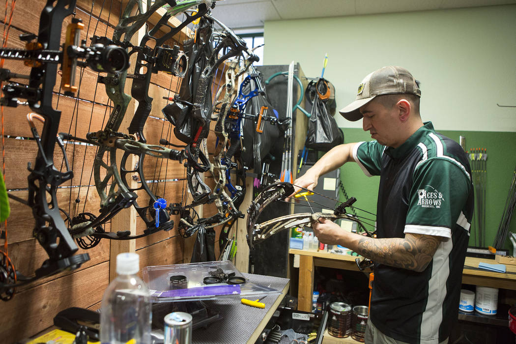 AJ Hanagata works on a bow at Aces and Arrows in Henderson, Thursday, Sept. 28, 2017. Hanagata and Ryan Sidor opened Aces and Arrows, a store and 22-lane range, in August. Bridget Bennett Las Vega ...