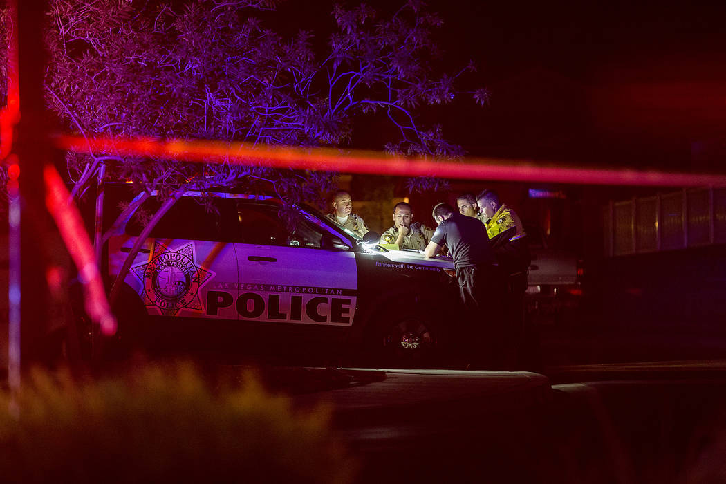 Officers are present in a northwest gated neighborhood near the intersection of North Fort Apache Road and West Grand Teton Drive on Thursday, Sept. 21, 2017, in Las Vegas. Bridget Bennett Las Veg ...