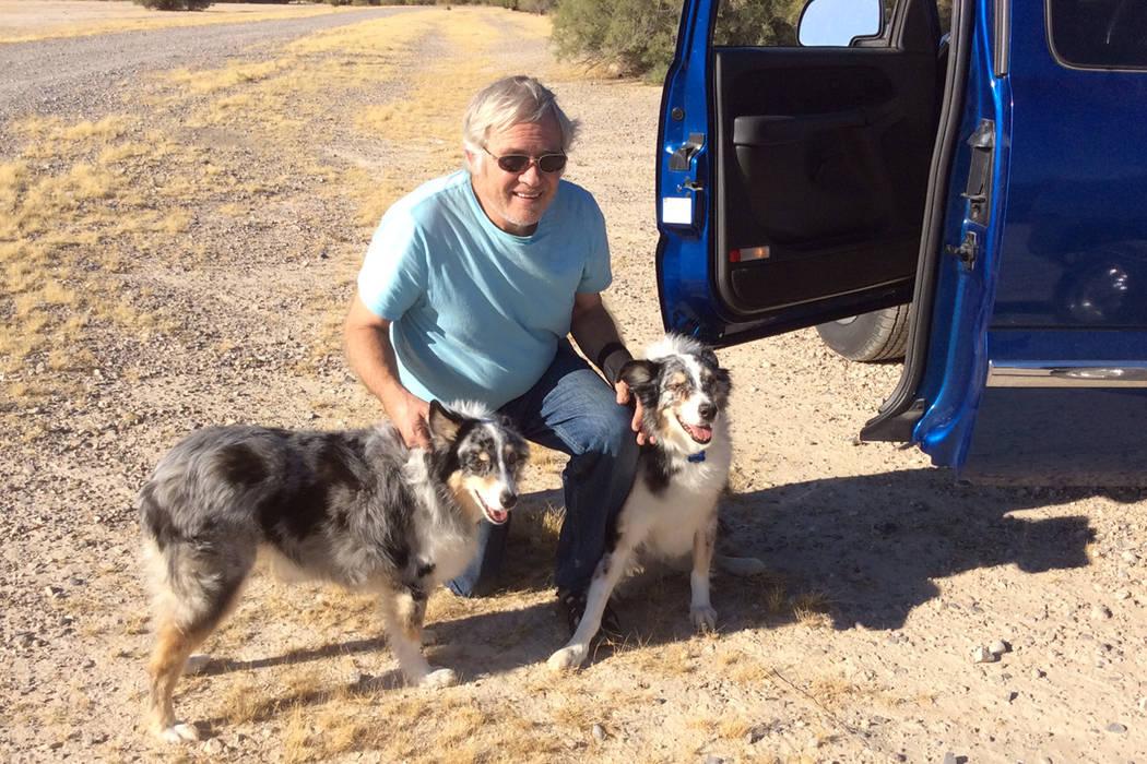 "Lloyd ""Wayne"" Ullyott, with his Australian Shepherds Jake and Daisy. (Karyn Ullyott)"