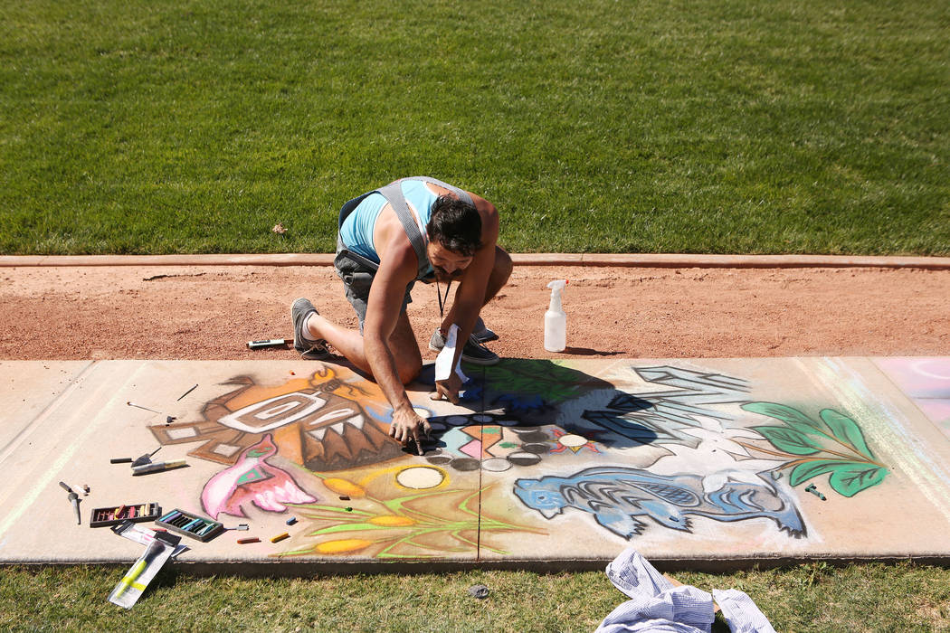 Kris Relph works on his chalk art in part of Chalk and Cheers at Skye Canyon Park in Las Vegas, Saturday, Sept. 30, 2017. Bridget Bennett Las Vegas Review-Journal @Bridgetkbennett