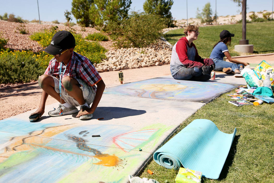 Tayen Cole-Burnside, 10, works on his chalk art in part of Chalk and Cheers at Skye Canyon Park in Las Vegas, Saturday, Sept. 30, 2017. Bridget Bennett Las Vegas Review-Journal @Bridgetkbennett
