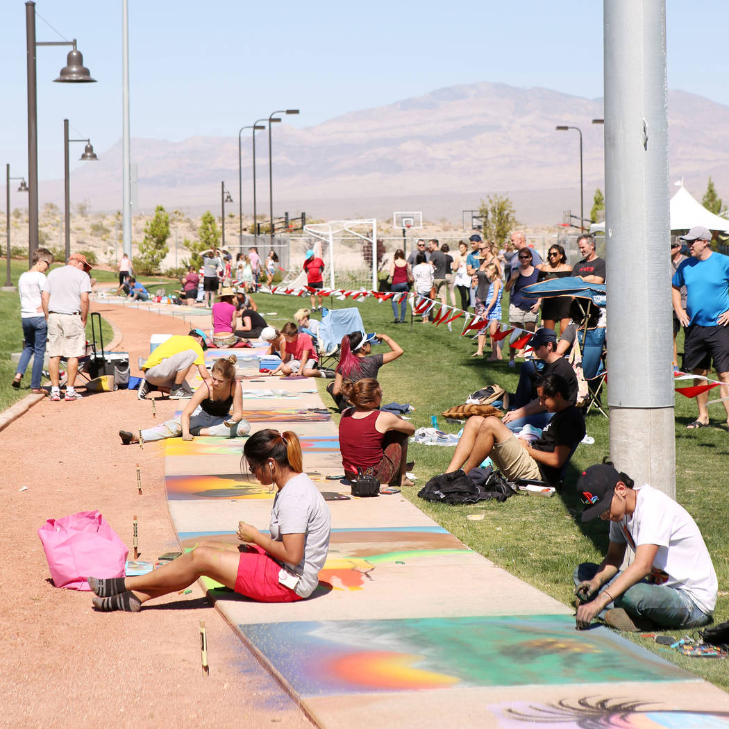Participants works on their chalk art in part of Chalk and Cheers at Skye Canyon Park in Las Vegas, Saturday, Sept. 30, 2017. Bridget Bennett Las Vegas Review-Journal @Bridgetkbennett