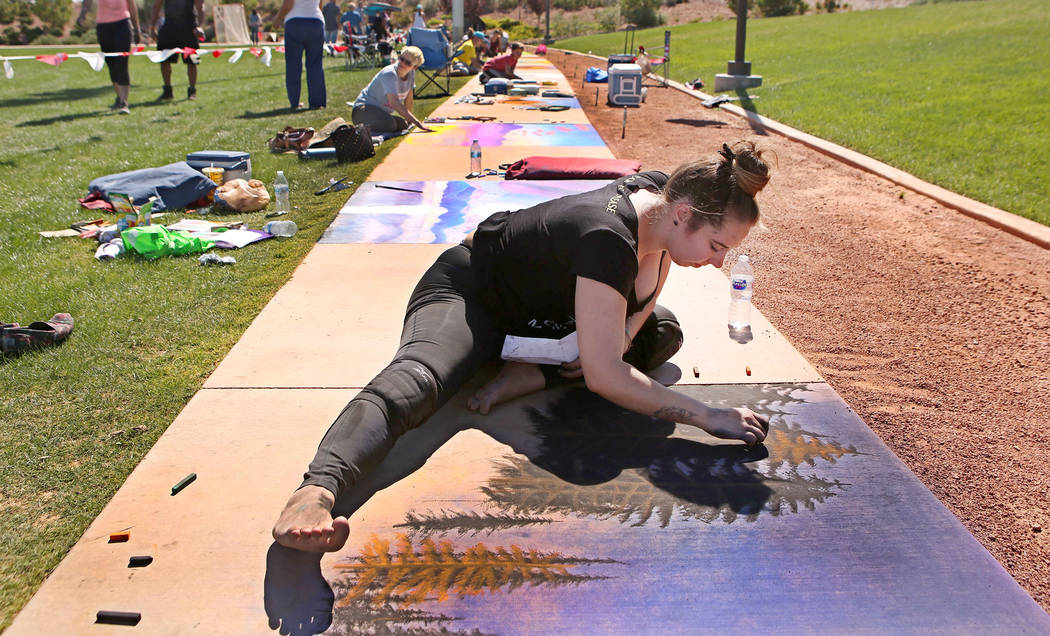 Michelle Cox works on her chalk art in part of Chalk and Cheers at Skye Canyon Park in Las Vegas, Saturday, Sept. 30, 2017. Bridget Bennett Las Vegas Review-Journal @Bridgetkbennett