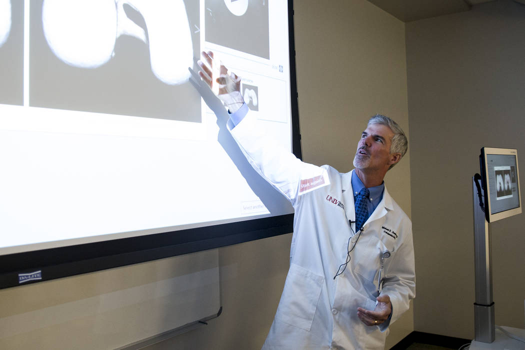 Dr. Michael Daubs, professor and chair of the UNLV Orthopedic Surgery Department, during a demonstration of the virtual surgery technology, VIRTAMED Arthros, at the UNLV School of Medicine in Las  ...