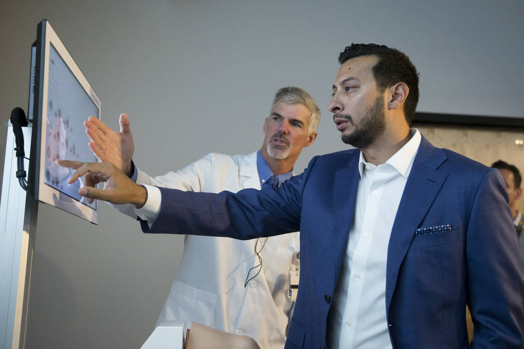 Dr. Michael Daubs, left, professor and chair of the UNLV Orthopedic Surgery Department, and Adnan Mohsin, surgical simulation coordinator, during a demonstration of the virtual surgery technology, ...