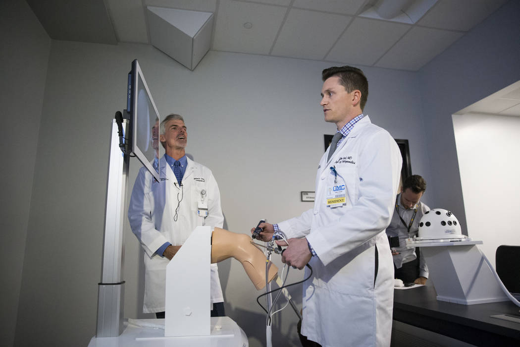 Dr. Michael Daubs, left, professor and chair of the UNLV Orthopedic Surgery Department,  and Tyler Kent, second year resident M.D. in the UNLV Department of Orthopedics, during a demonstration of  ...