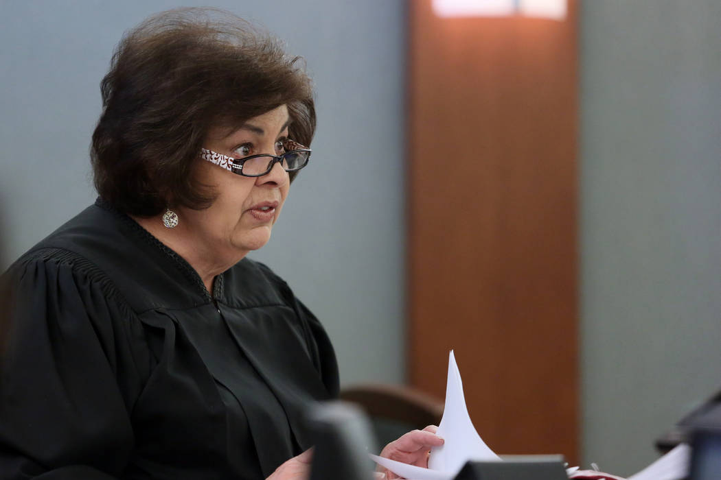 Justice of the Peace Deborah Lippis presides over a case at the Regional  Justice Center on 8fb17b742b
