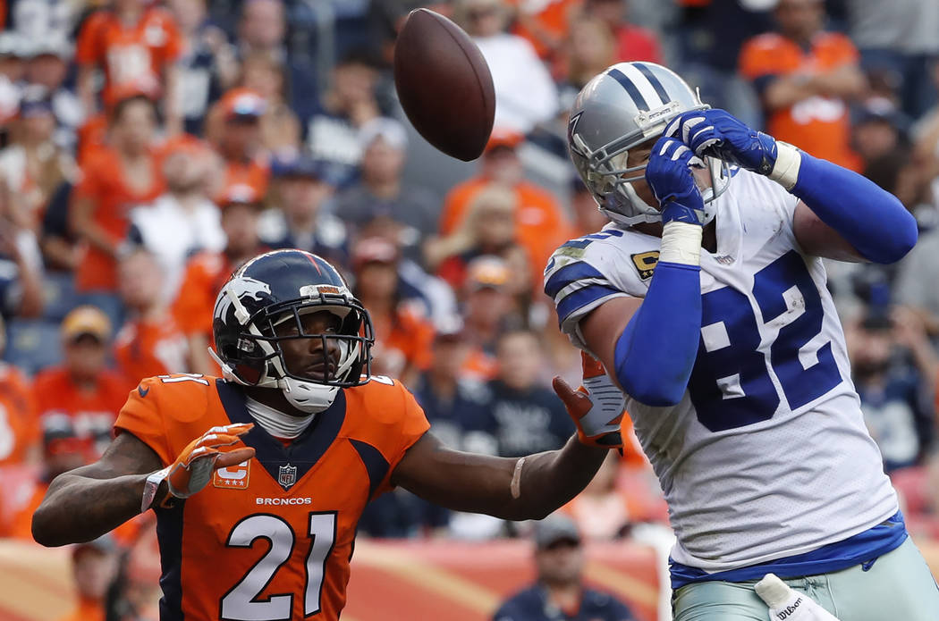 Dallas Cowboys tight end Jason Witten (82) misses a pass as Denver Broncos cornerback Aqib Talib (21) defends during the second half of an NFL football game, Sunday, Sept. 17, 2017, in Denver. (AP ...