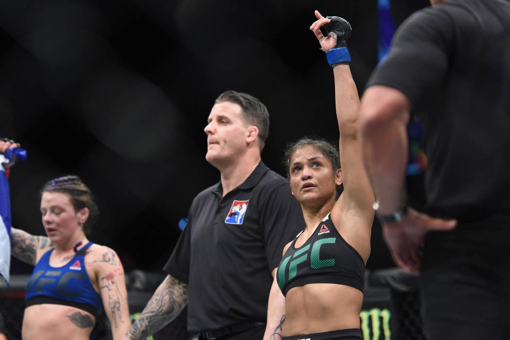 Jul 16, 2017; Glasgow, Scotland, United Kingdom; Cynthia Calvillo (right) reacts after defeating Joanne Calderwood (left) during UFC Fight Night at SSE Hydro. Mandatory Credit: Per Haljestam-USA T ...